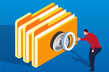 Businessman holding magnifying glass analyzing folder password